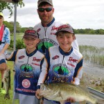 Ben, Hardy, and Jackson Franklin with their Big Bass